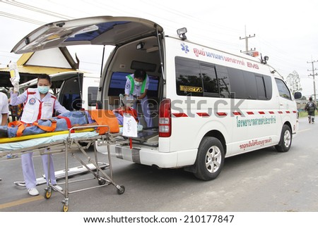 NAKHONSAWAN/THAILAND-JULY 31: Exercise Management for group accident on July 31, 2014 in Nakhonsawan. The victims are carried to Medical vans for sending to the hospitals. - stock photo