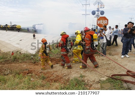 NAKHONSAWAN/THAILAND-JULY 31: Exercise Management for group accident on July 31, 2014 in Nakhonsawan. Firemen try to stop the fire. - stock photo