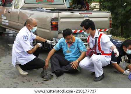 NAKHONSAWAN/THAILAND-JULY 31: Exercise Management for group accident on July 31, 2014 in Nakhonsawan. Driver victim from private pickup car is help by Medical Personnel. - stock photo