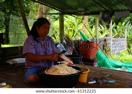 NAKON NAYOK, THAILAND - SEPTEMBER 14: Thai woman prepares Thai food on September 14, 2010 in Nakon Nayok. - stock photo