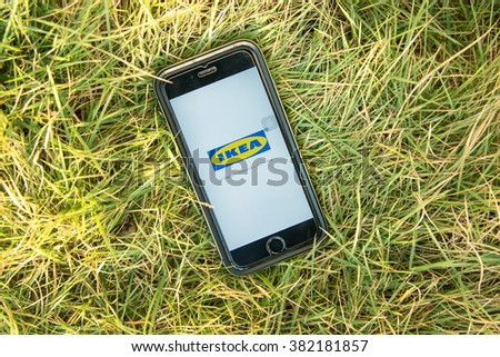 NAKORN PATHOM, THAILAND - FEB 15, 2016: top view screen shot of IKEA apps showing on iPhone6 on grass - stock photo