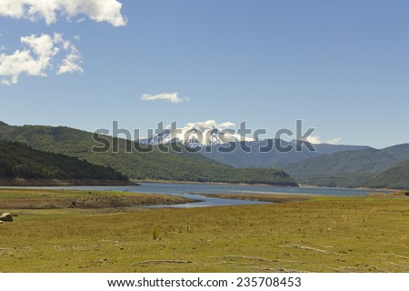 Nalcas National Park, Chile. The Bio Bio river, and in the background snowy volcano Lonquimay - stock photo