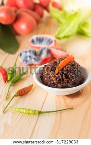 Nam Prig Pha, Thai spicy chilli dip on wood background - stock photo