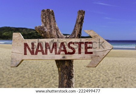 Namaste wooden sign with a beach on background - stock photo