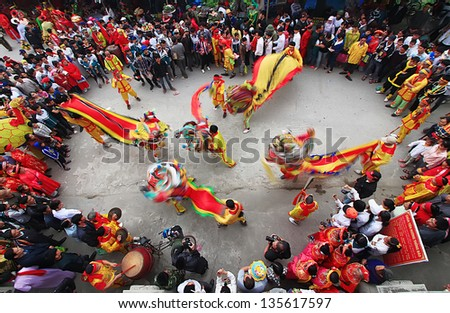 NAMDINH, VIETNAM - APRIL 14: A group of unidentified boys dance with their colorful lion during  performances at Phu Giay festival on APRIL 14, 2013 in NAMDINH City, VIETNAM - stock photo