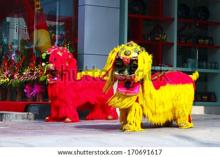 NAMDINH, VIETNAM - DECEMBER 8: A group of unidentified boys dance with their colorful lion during performances on December 8, 2013 in NAMDINH City, VIETNAM. - stock photo