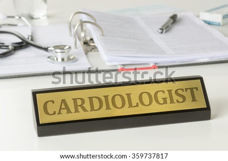 Name plate on a desk with the engraving Cardiologist - stock photo