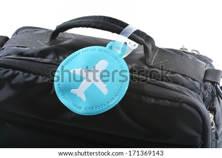 Name tag with round shape on the black luggage - stock photo