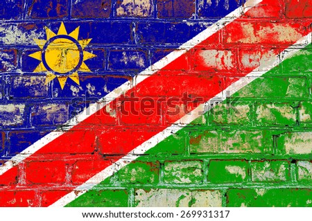 Namibia flag painted on old brick wall texture background - stock photo