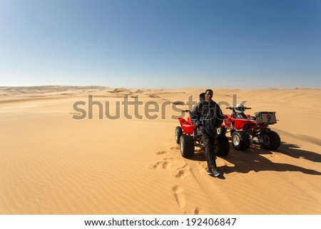 NAMIBIA - OCTOBER 27 2013: Quad biking can cause impact on the diverse sand dune ecosystem if not done in a sustainable way in Namibia, Africa - stock photo
