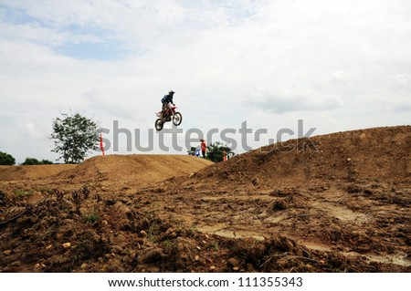 NAN, THAILAND - JUN 02: An unidentified rider participates in the 3rd round (test drive) of Motocross 2012 Thailand motocross Junior championship on June 02, 2012 in Nan Province, Thailand. - stock photo