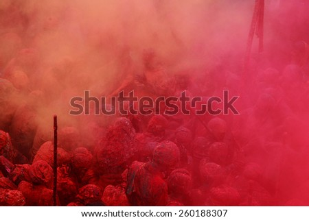 NANDGAON - FEB 28: Devotees throw colors to each other during the Holi celebration at Krishna temple on February 28, 2015 in Nandgaon, India. Holi is the most celebrated religious festival in India. - stock photo