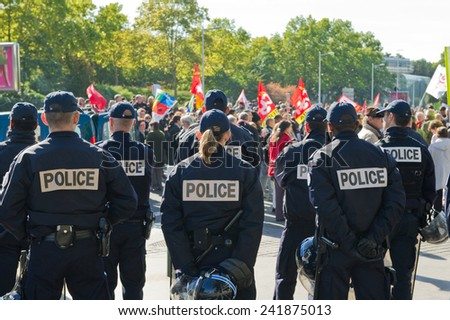 NANTERRE, FRANCE - OCTOBER 10, 2010 : French police in Nanterre in front of the administrative center of the city to prevent spillage during the demonstration against pension reform - stock photo