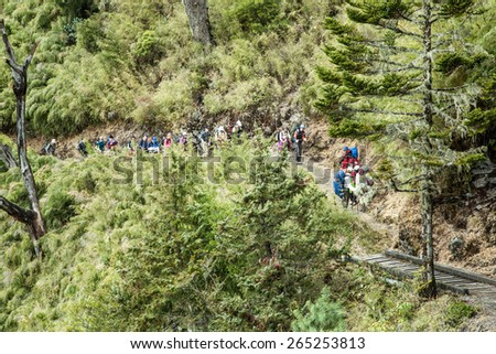 NANTOU, TAIWAN, MARCH 28 2015, Walking in Jade Mountain, the highest mountain of Taiwan. - stock photo