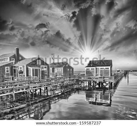 Nantucket, MA. Beautiful Port view with Wooden Homes at sunset. - stock photo