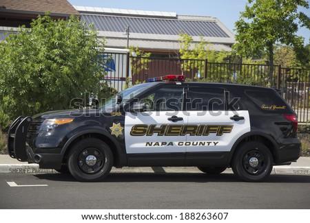 NAPA VALLEY, CA - APRIL 16: Napa County sheriff's car in Yountville on April 16, 2014. - stock photo