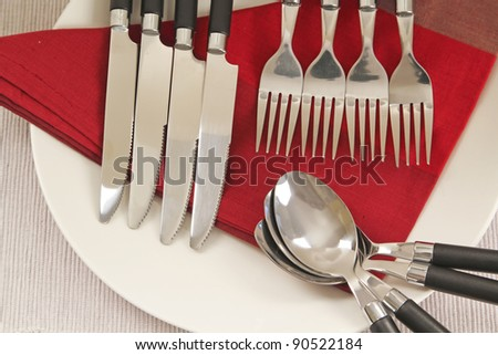 Napkin and knifes, spoons and forks - stock photo