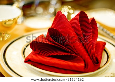 Napkin in the plate - wedding dinner - stock photo