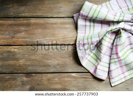 Napkin on wooden table - stock photo