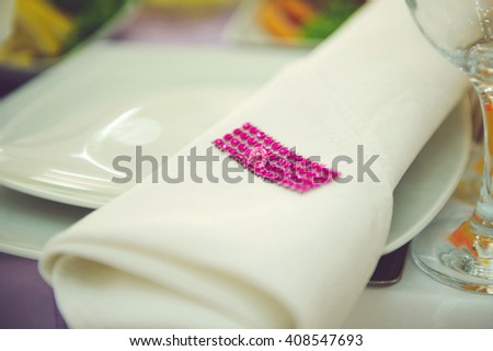 napkin with pink crystals on plate - stock photo
