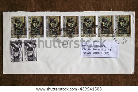 NAPLES, ITALY - JUNE 12, 2016: Old envelope with italian stamps on it, which was dispatched from Rome to Minturno, Italy, on January 10, 1982. - stock photo