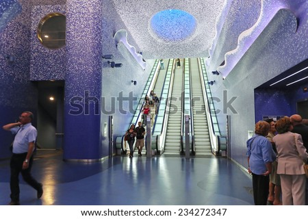 NAPLES, ITALY - JUNE 25: Toledo Metro Station in Naples on JUNE 25, 2014. Escalators with commuters in Toledo Art station designed by Spanish Architects Firm Oscar Tusquets Blanca in Naples, Italy. - stock photo