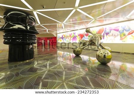 NAPLES, ITALY - JUNE 25: University Metro Station in Naples on JUNE 25, 2014. Eclectic sculpture at Universita Art station designed by architect Karim Rashid in Naples, Italy. - stock photo