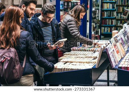 NAPLES, ITALY - MARCH 20, 2015: People looking around in the second hand book stalls of the book market in the historical center of Naples, Italy - stock photo