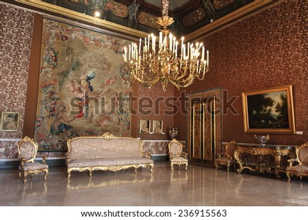NAPOLI, ITALY - MARCH 13, 2009: Grand hall of Napoli palace on March 13, 2009 in Napoli, Italy. The Napoli palace is a unesco world heritage and a landmark in Southern Italy. - stock photo