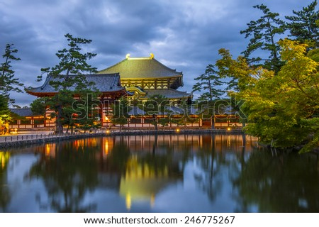 Nara Daibutsu Todai-ji  reflecting in a pond after the sunset. This Buddhism temple is hiding the statue of the largest sitting Buddha statue in the world.  - stock photo