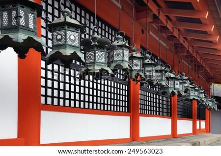 NARA, JAPAN-NOVEMBER 6, 2014;Kasuga Taisha Shrine is famous for its lanterns Hundreds of bronze lanterns are hanging from the buildings.It is an UNESCO World Heritage site.November 6, 2014 Nara,Japan  - stock photo