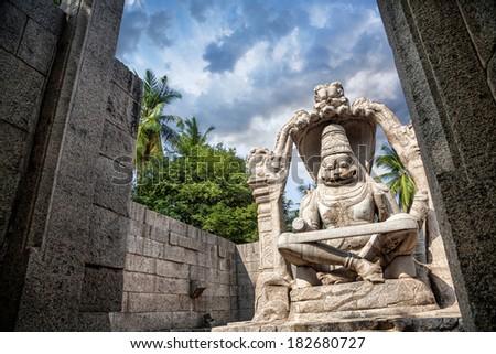 Narasimha stone statue in Hampi, Karnataka, India - stock photo
