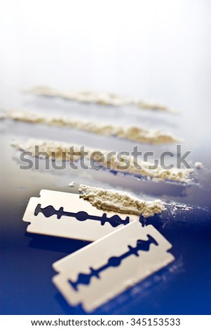 Narcotics abuse - cocaine drug use - criminality problem - stock photo