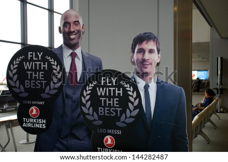 NARITA, JAPAN - JULY 19: Kobe Bryant and Leo Messi on July 19, 2013,Narita, Japan. The sport star on the Turkish Airlines advertisement at Narita Airport. TA was the best airline in Europe in 2012. - stock photo
