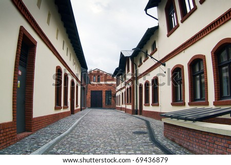 Narrow alley between tenement houses in Cracovia. - stock photo