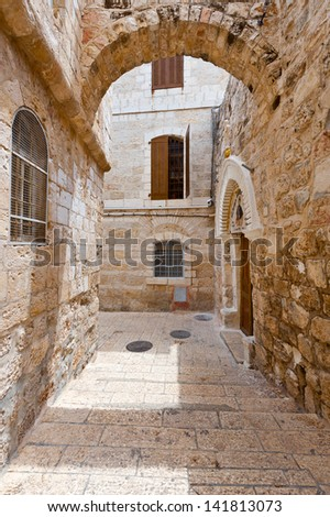 Narrow Alley in the Armenian Quarter of Jerusalem - stock photo