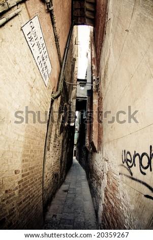 Narrow alley in Venice, Italy - stock photo
