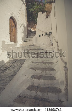 Narrow Alley With Old Buildings in Greece - stock photo