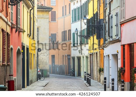 Narrow beautiful street with colorful houses in Parma, Emilia Romagna province, Italy. - stock photo