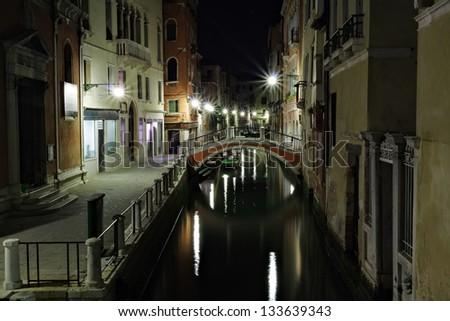 Narrow canal in Venice at night Italy - stock photo