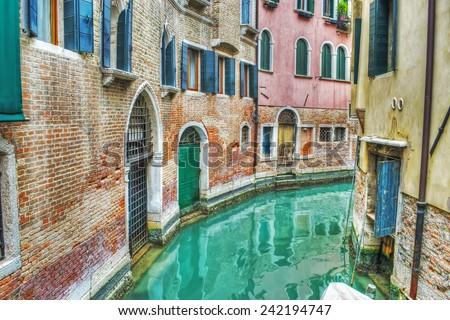 narrow canal in Venice, Italy - stock photo