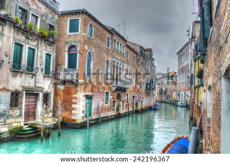 Narrow canal in Venice under a gray sky. Heavy processed for hdr tone mapping effect. - stock photo