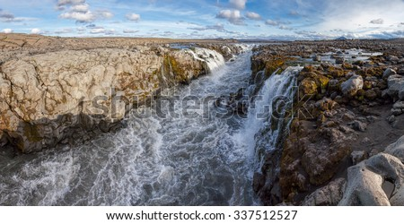 Narrow canyon of the glacier river Joekulsa a Fjoellum in the Highlands of Iceland near the Herdubreid Mountain panoramic shot - stock photo
