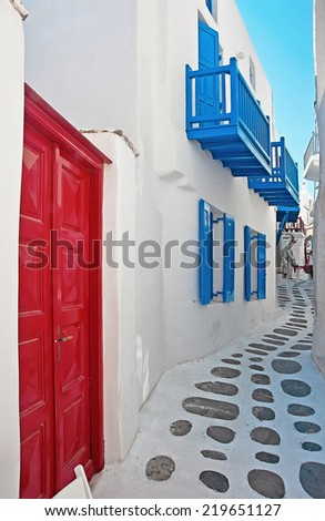 Narrow colorful street in old part of Chora of Mykonos island Greece - stock photo