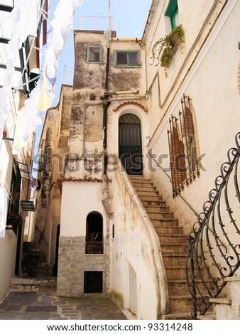 Narrow lane in southern Italy - stock photo