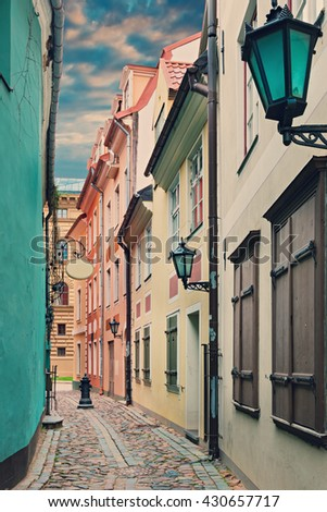 Narrow medieval street in the old Riga city, Latvia. In 2014, Riga was the European capital of culture  - stock photo