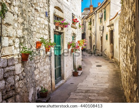 Narrow old street and yard in Sibenik city, Croatia, medieval zone - stock photo