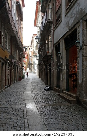 Narrow old street from Porto, Portugal. Early morning light. - stock photo