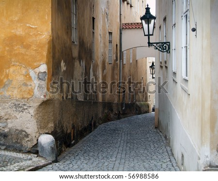 Narrow pedestrian alley between tenement houses in Prague. Stare Mesto. Old town. - stock photo