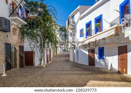 Narrow pedestrian streets in Ibiza old town center. Baleares, Spain - stock photo